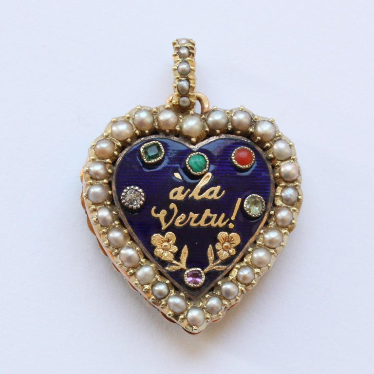 A two sided Georgian gold locket, one side with a pearl border and hoop with a blue enamel plaque on the inside set with different gemstones and in gold the text: 'à la vertu' (to virtue) adn two gold flowers, the reverse says: 'L'amitié les a