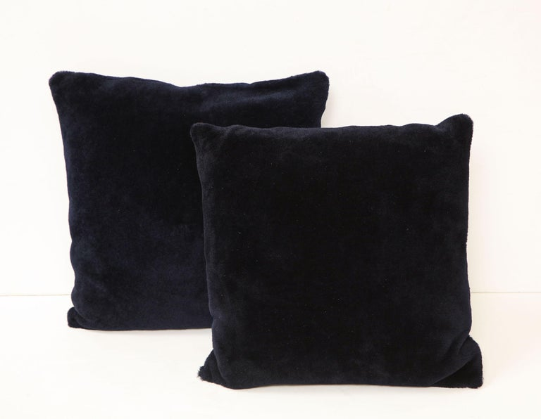 Double sided Merino short hair shearing pillow in midnight blue color. Beautiful accessory piece with rich and deep color. It is made of genuine shearing with a zipper enclosure in a matching color, filled with down and feather, and 18