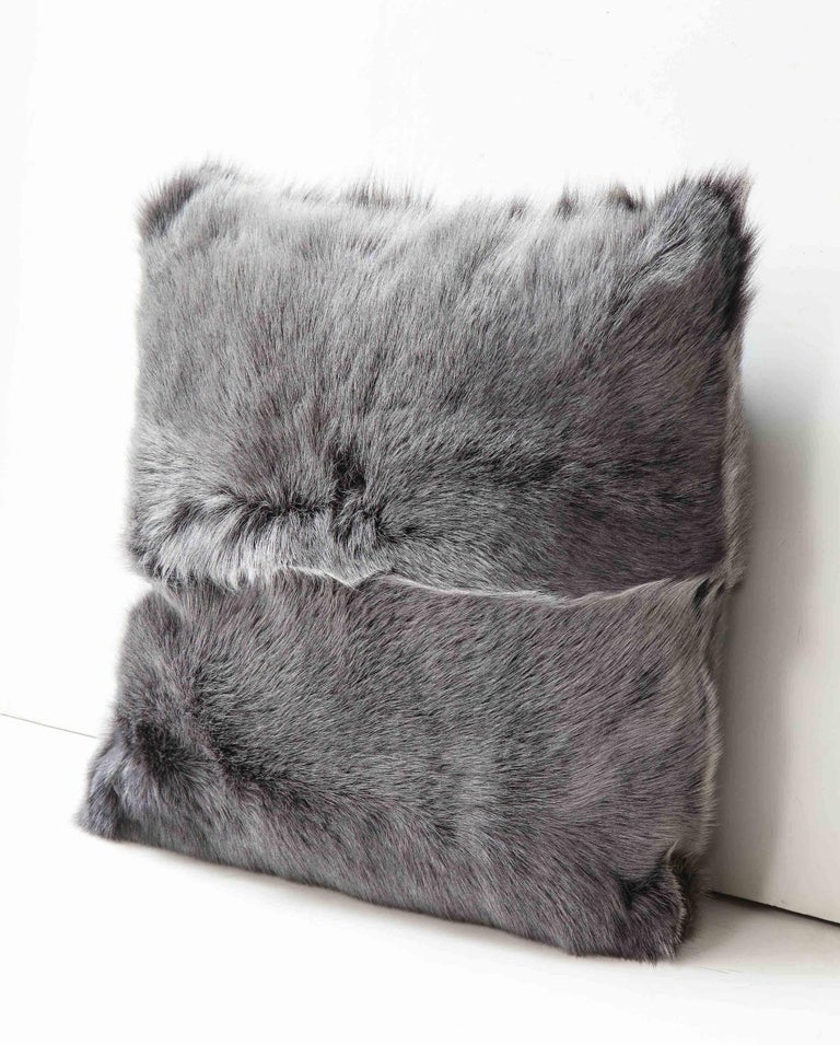 Beautiful double sided long hair Toscana shearing pillow in grey color. Very elegant in look and tangibly luxurious and soft. It is made of genuine shearing with a zipper enclosure in a matching color, filled with down and feather, and 18