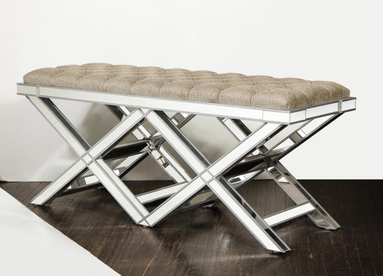 Custom double silver trim mirrored X-band bench with upholstered tufted fabric cushion. Customization is available in different sizes, finishes, and fabrics.