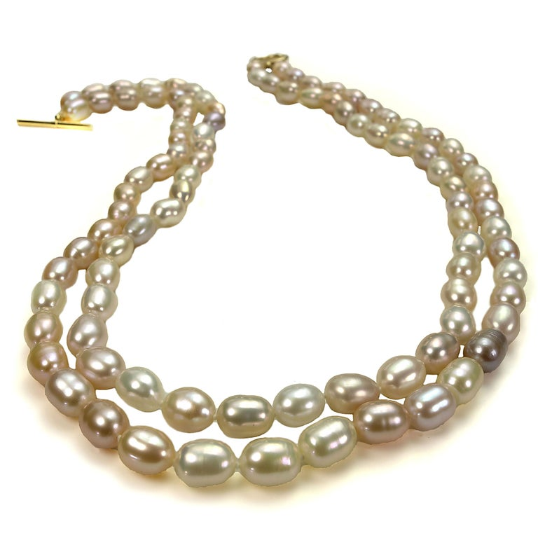 Delicate peach color Oval shape Freshwater Pearl Necklace. Peach is the predominant color, additionally there are creamy and mauve shades of pearls. This unique necklace is so classic you can wear it all the time and everywhere. It is one of those