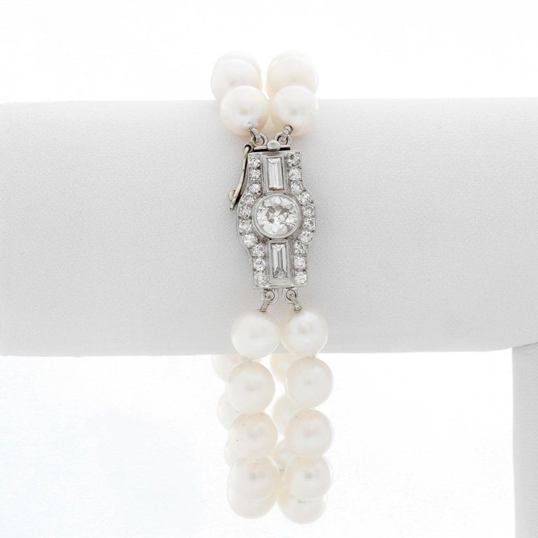 Double Strand Pearl Bracelet With Diamonds - Art deco style bracelet with 2 strands of pearls and an oversized diamond clasp. Bracelet measures approx. 6 1/2 inches with approx. 1 ct of diamonds. Pre-Owned .