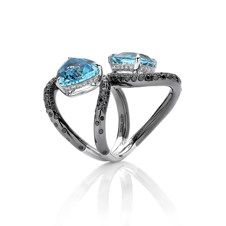 From the 'Intrecci' Collection, one-of-a-kind double trillion cut aquamarine ring set in 18 karat white gold with black rhodium finish and pave-set black diamond detailing.   The beauty is in the details - from the combination of hues, the color of