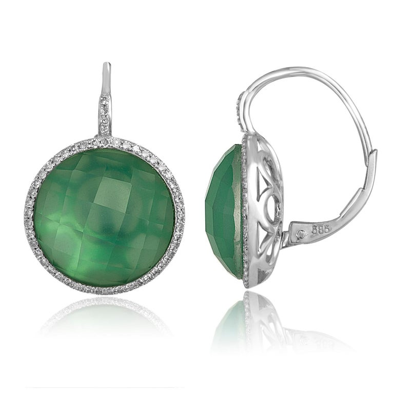 Sliced to display their natural variations in character. The green agate slice is topped with clear faceted white topaz. The slices are set in 14K White Gold and surrounded by Diamonds. There are 0.29ct in Diamonds H/I SI. There are 9.23ct in White