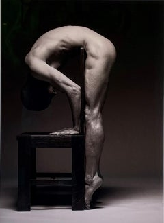 Centerfold - Muscular Male Nude Bent Over Wooden Chair, Black & White Photograph