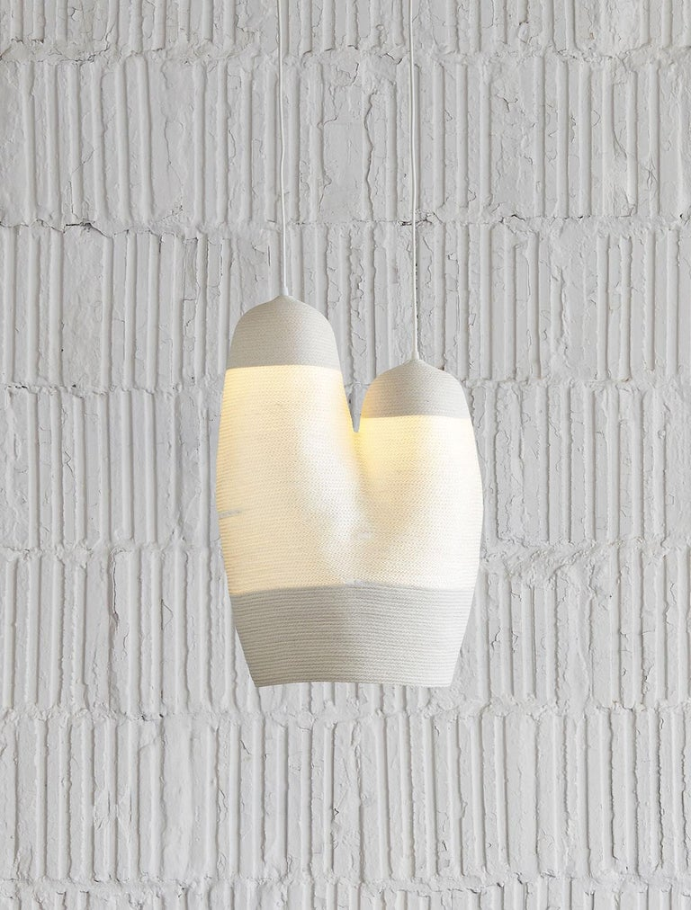 Beautiful hanging light of coiled and sewn cotton and nylon cord, by contemporary designer Doug Johnston. The cotton cording is opaque while the nylon allows the light to come through. Entirely handmade to order in New York. Includes one 4.75