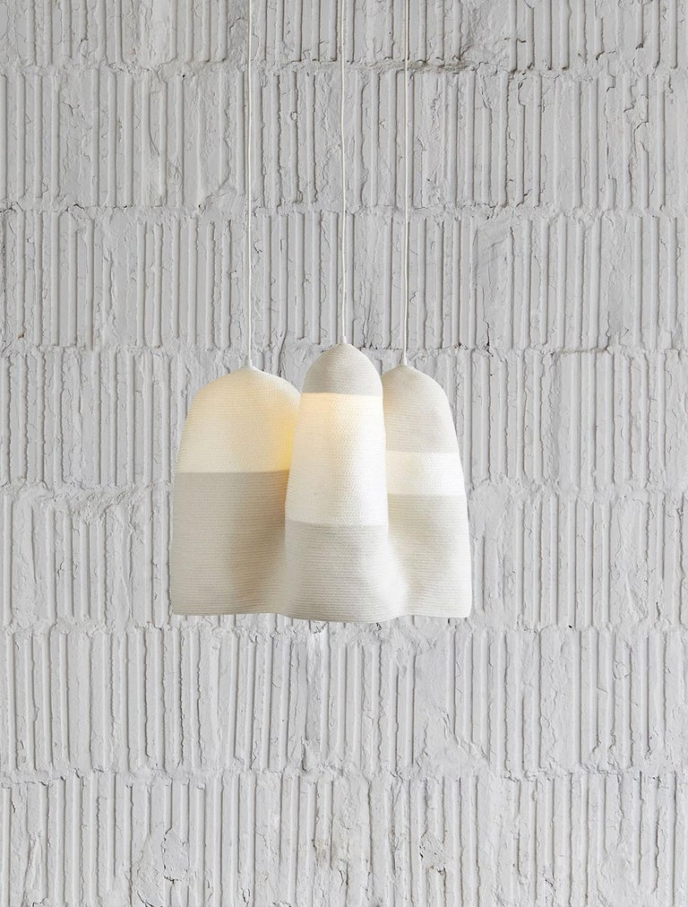 Beautiful textile hanging light of coiled and sewn cotton and nylon cord, by contemporary designer Doug Johnston. The cotton cording is opaque while the nylon allows the light to come through. Entirely handmade to order in New York. Includes one