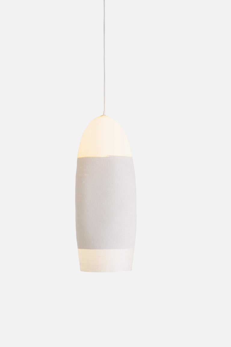 Beautiful hanging light of coiled and sewn cotton and nylon cord, by contemporary designer Doug Johnston. Entirely handmade to order in New York. Includes one 4.75