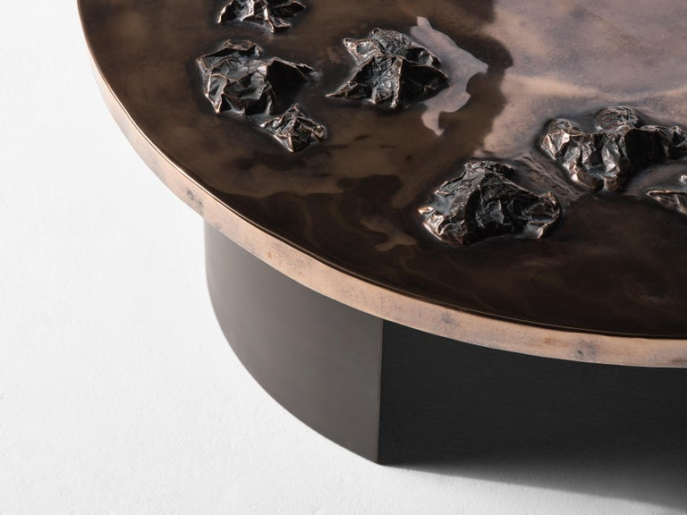 Master metalsmith Douglas Fanning's extra elegant coffee table features an extended series of topographical crests spanning abutting a third of its smooth top. Fanning, always eager to explore new territories in form and material, has in this case