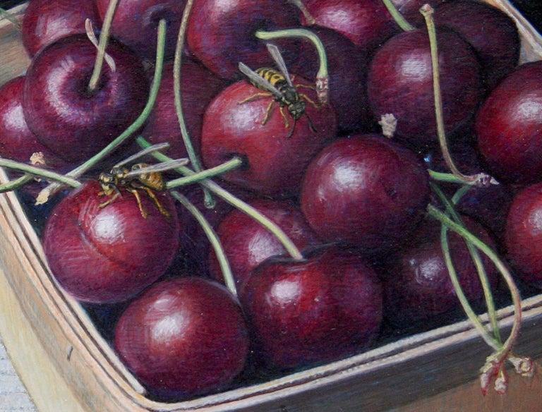 Bing Cherries in a Pint Basket, surreal egg tempera still life painting, 2020 - Painting by Douglas Safranek