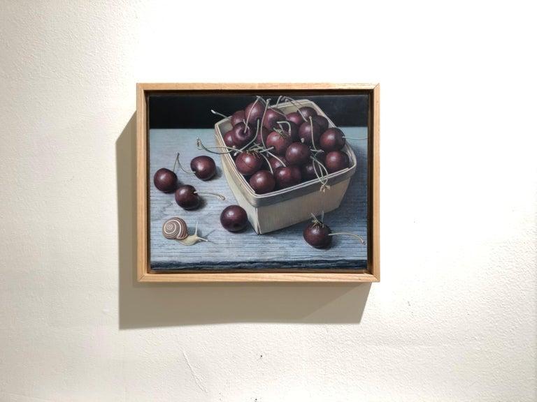 Bing Cherries in a Pint Basket, surreal egg tempera still life painting, 2020 - Black Animal Painting by Douglas Safranek