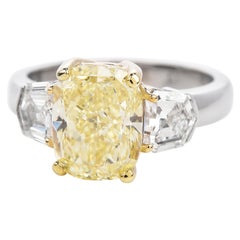 Dover 4.66ct GIA Certified Fancy Light Yellow Three Stone Engagement Ring