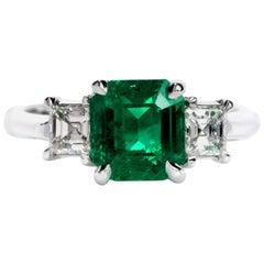 Dover Diamond Colombian Emerald Asscher Cut Diamond Platinum Three-Stone Ring