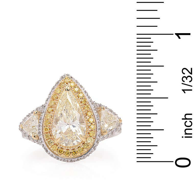 Diamond Natural yellow Pear Diamond Platinum Gold Engagement Ring In Excellent Condition For Sale In Miami, FL