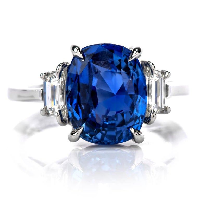 Your dream ring is now a tangible reality with this profound Large, Blue Cushion Cut Burma Sapphire & Diamond Platinum ring! Let yourself get carried away in the large 5.50 carat center sapphire of Burma origin all Natural with No heat Treatment.