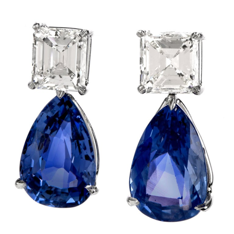 These stunning natural blue sapphire and diamond drop earrings are hand crafted in solid platinum. weighing 10 grams and measuring 24mm long x 11mm wide. Exposing a pair of prong-set, pear brilliant-cut natural corundum Sri Lanka blue sapphires,