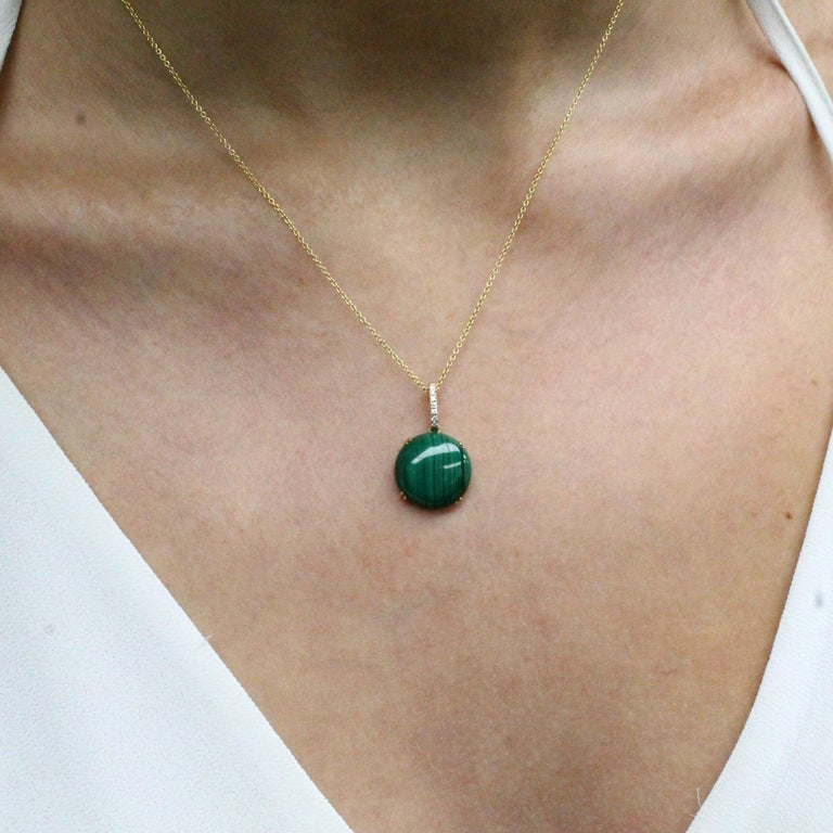 Verde Collection Necklace, with Round Cabochon-cut Malachite, a Diamond Bale, in 18K yellow gold. 18-inch 18K chain, with a 16-inch adjuster. Malachite is stone of balance and abundance, and often called