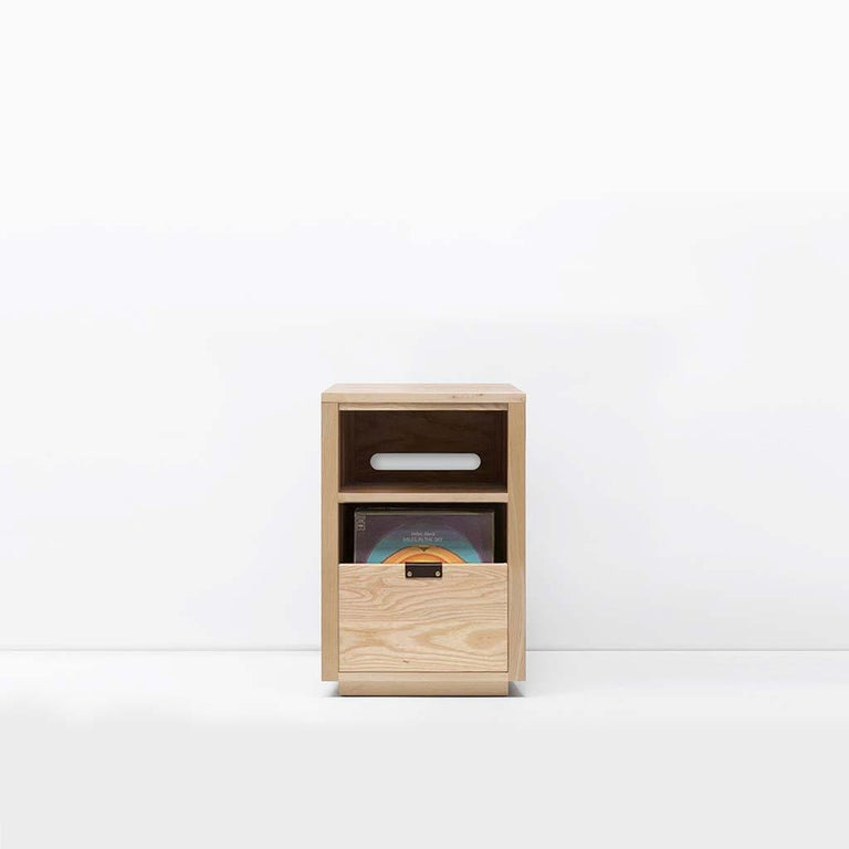 """Our Dovetail vinyl storage cabinets utilize a """"file drawer"""" approach to store LPs and allow you to easily flip through an entire record collection while enjoying a visual display of record cover art across the front of the cabinet. The design"""