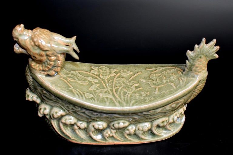 A song dynasty style porcelain pillow of the Long Quan kiln. The long Quan kiln is one of the most important song dynasty kilns. Started 1600 years ago, it produces celadon green and lotus leaf green glazed pieces with subtle under-glaze engraving.