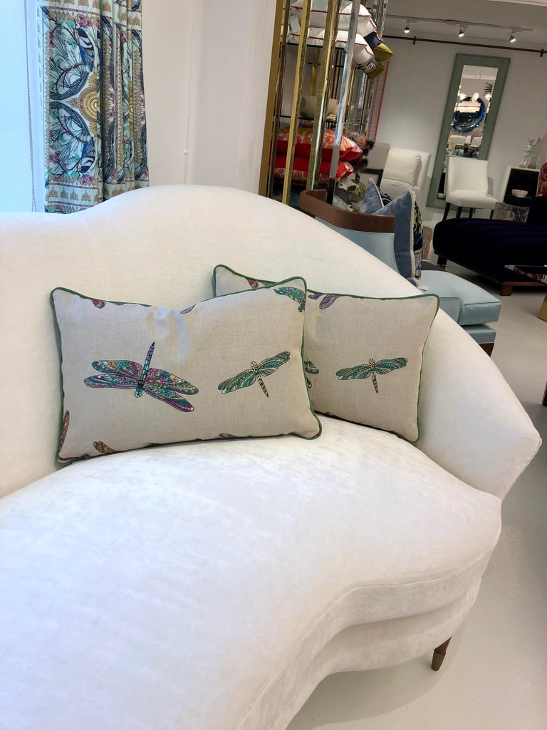 """A pair of lumbar throw pillows featuring vibrant and colorful dragonflies intricately embroidered on a linen blend fabric by Osborne and Little. All pillows are handmade at our studio in Norwalk, CT.  Measurements:  15"""" H x 24"""" W."""