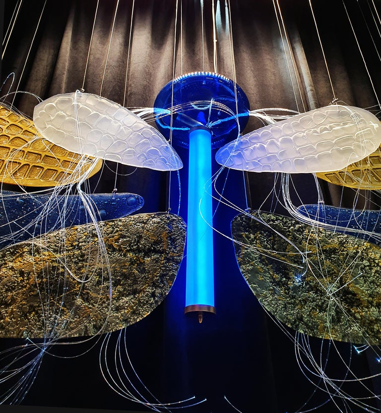 A sculpture, an art installation on a wall, or a lamp combine many elements of art. Inspired by real dragonfly wings, this work of art was shown for the first time in 2019 at the Hotel Show Dubai, which attracted crowds of visitors. The second