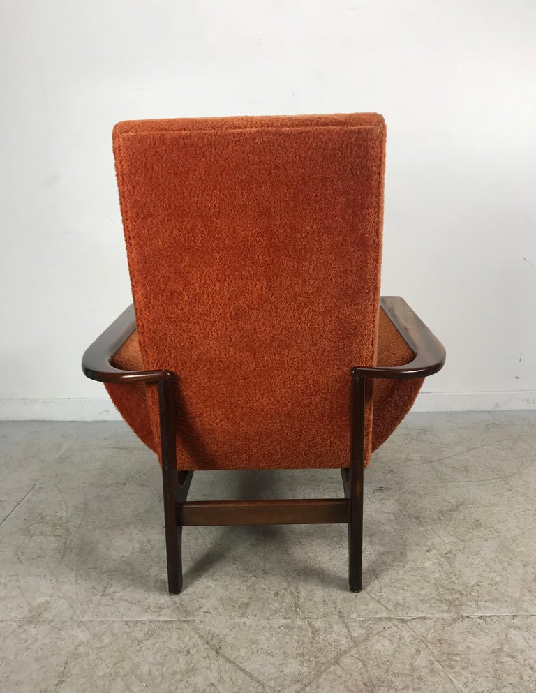 Sculptural Mid-Century Modern Lounge chair designed by Luigi Tiengo for Cimon, Montreal. Amazing, stylish design from any angle, sculptural walnut wraparound walnut, reminiscent of the Classic design styling's of Adrian Pearsall. Retains original
