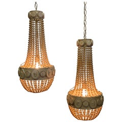Dramatic Pair of Hollywood Regency Beaded Pendant Chandeliers