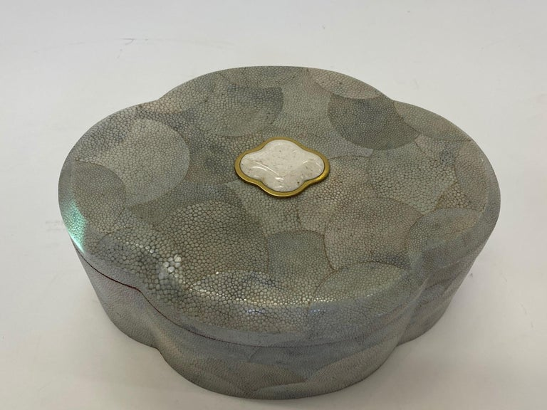 A generously sized beautifully crafted scalloped shaped shagreen lidded box having wooden interior and lovely bone decoration on top.
