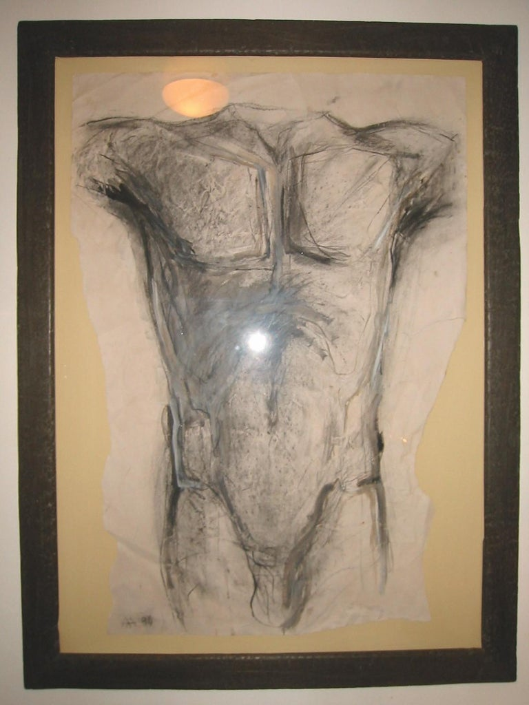 Framed drawing of a Torso by Greek born artist Alexandra Athanassiades (b. 1961). Composition: Charcoal and gouache on distressed paper.  Property from esteemed interior designer Juan Montoya. Juan Montoya is one of the most acclaimed and prolific
