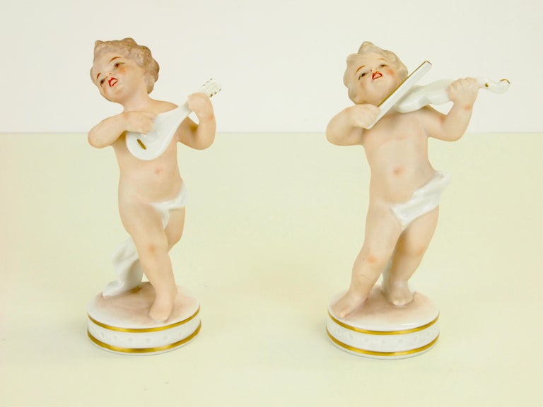 German Dresden Porcelain Figurines Depicting 2 Music Playing Cherubs by Carl Thieme For Sale