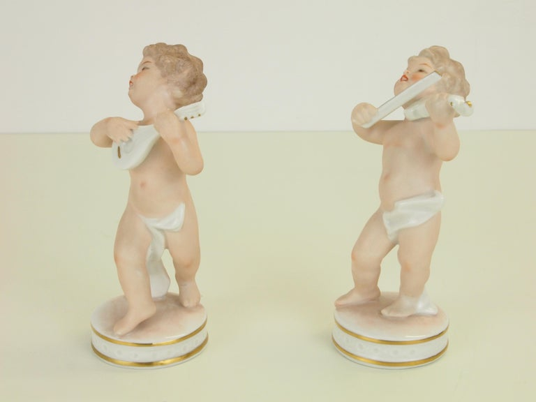 Glazed Dresden Porcelain Figurines Depicting 2 Music Playing Cherubs by Carl Thieme For Sale
