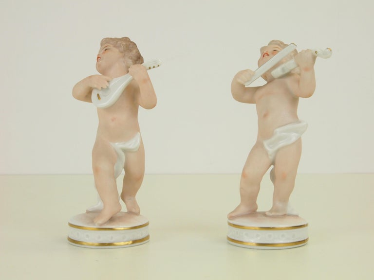 20th Century Dresden Porcelain Figurines Depicting 2 Music Playing Cherubs by Carl Thieme For Sale