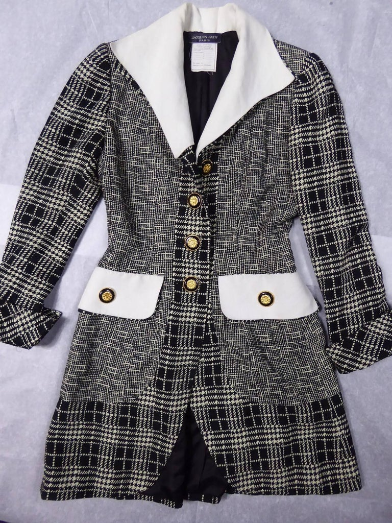 Circa 1990  France  Dress cocktail black and white of Jacques Fath and dating back to the 1990s. Track Jacquard black and white mottled effect and tiles. Dress coat of inspiration Board of Directors at buttoning front, pockets, collar and removable