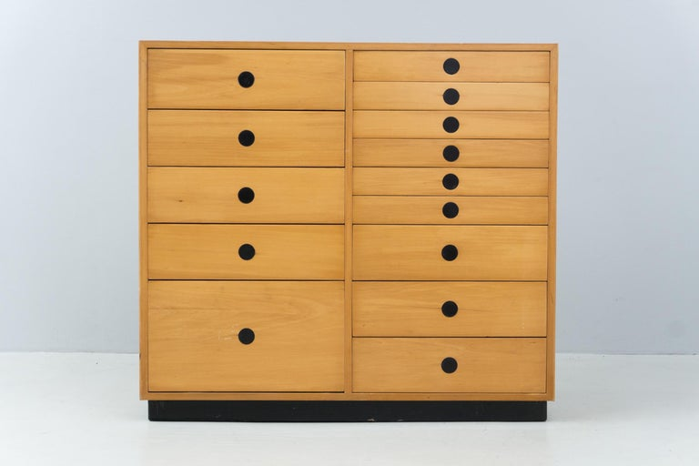 Chest of drawers with various drawers in different sizes. Made of solid ash wood and ash veneer. Black metal base, black metal handles. Manufactured by Arform, Italy, 1959  'Paolo Tilche (1925 – 2003) Born in Egypt, he graduated from the