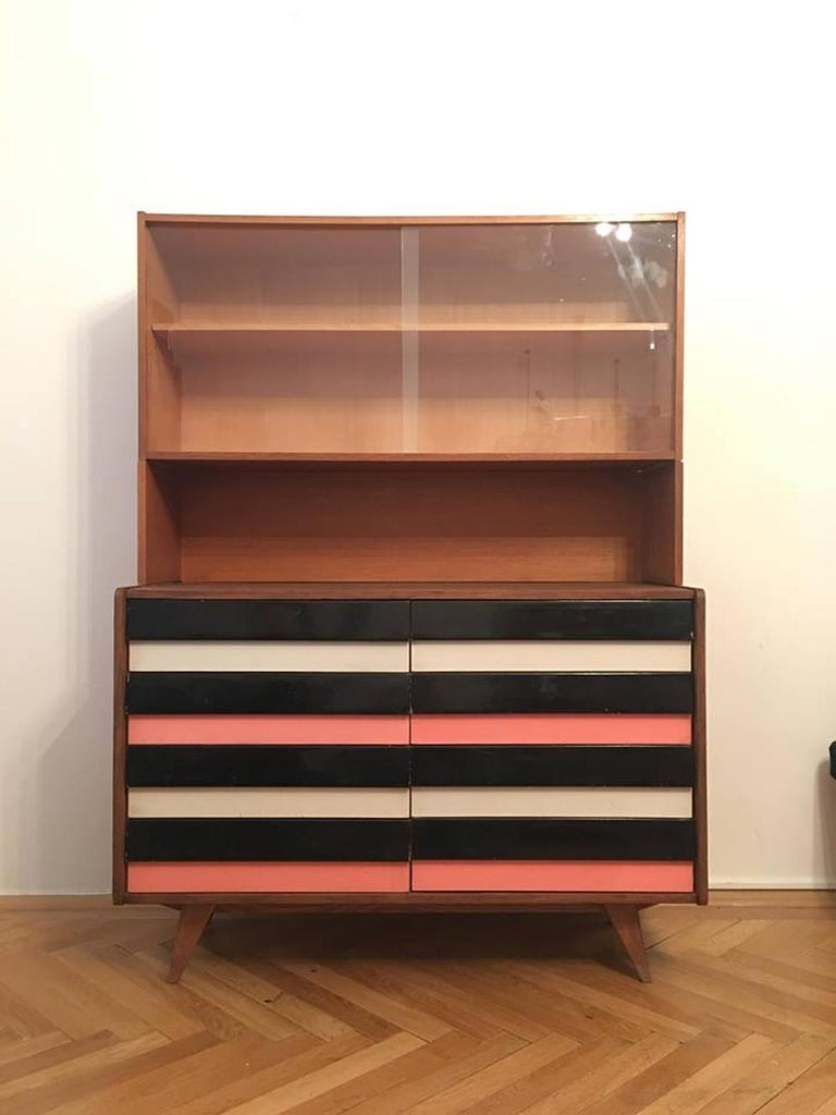 Original vintage chest of drawers with the bookcase. Drawers are in black and pink and grey-blue combination. Type U-453, manufactured in the 1960s by Interier Praha, designed by Jiri Jiroutek. Wooden construction, drawers are made of plastic, the