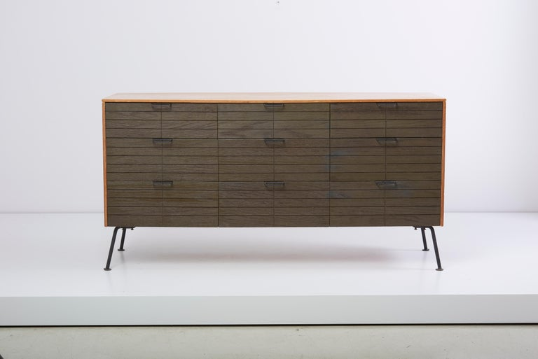 Nine-drawer dresser with vanity mirror and matched stool designed by Raymond Loewy for Mengel Furniture Company. The stool is D 43 x W 43 x H 47 cm.