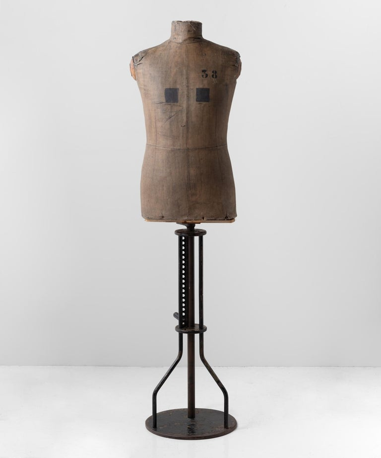 Dressmakers Display Mannequin, Northern European, circa 1920.  Raised on adjustable metal base, with painted metal, carton cache and painted fabric.
