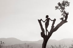 Boy In Tree Looking Over Land, Ethiopia, Africa, Iconic, Horizontal