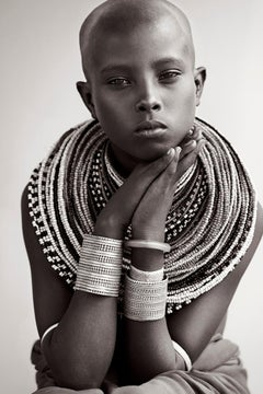 Portrait of a Young Woman Wearing Traditional Tribal Jewelry, Africa, Fashion