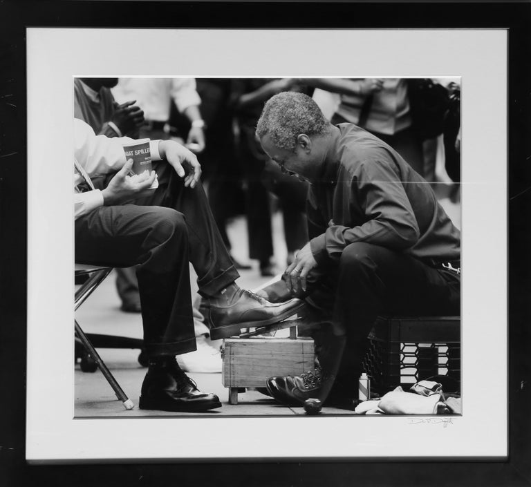 Artist: Drew Doggett Title: Shoeshine Medium: Archival Pigment Print, signed on the matting Size: 20 x 23 inches Framed Size: 29 x 32 inches