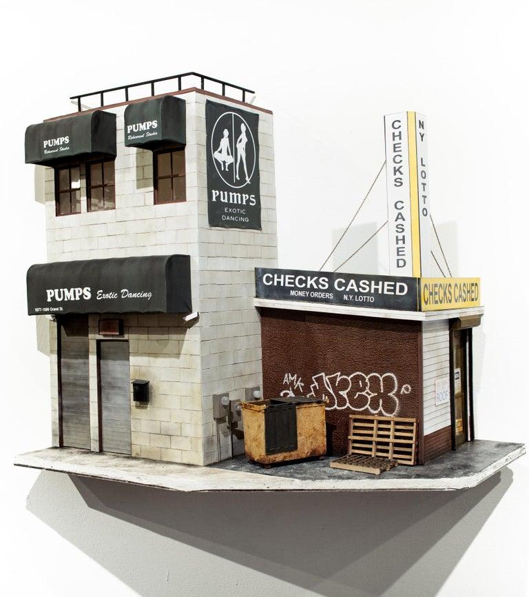"""Drew Leshko Figurative Sculpture - """"Pumps,"""" Miniature City Buildings, Cityscape, Architecture, Paper Sculpture"""
