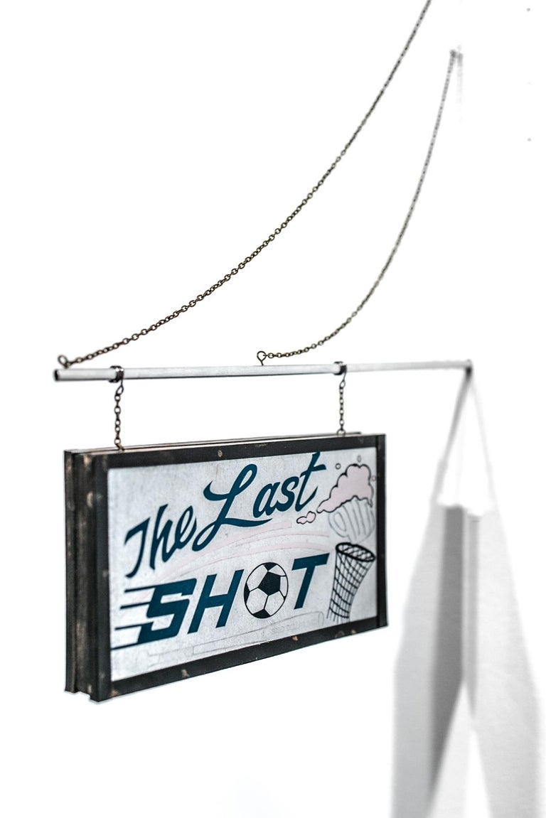 """""""The Last Shot"""" is an original paper, enamel, pastel, inkjet prints, chain, wire, and tubing artwork by Drew Leshko measuring approx. 11""""h x 8""""w x 0.75""""d.  Drew Leshko is a Philadelphia, Pennsylvania-based artist.  By carving, cutting, and layering"""