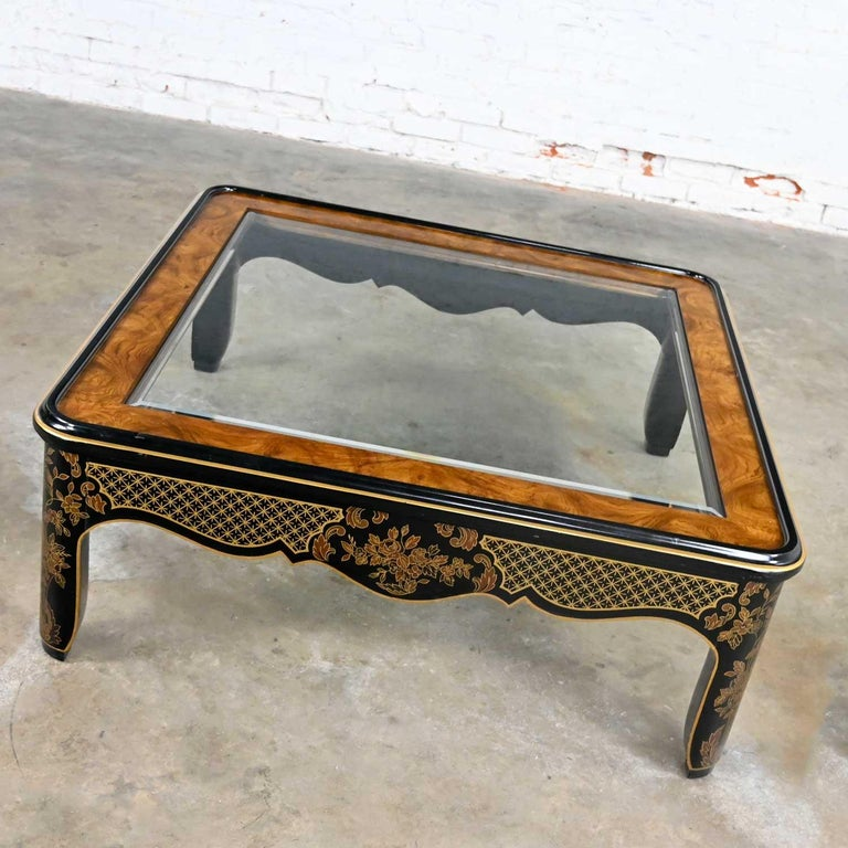 Magnificent Drexel Heritage ET Cetera collection chinoiserie black & gold painted & burl coffee table with beveled glass insert top. Beautiful condition, keeping in mind that this is vintage and not new so will have signs of use and wear. We have
