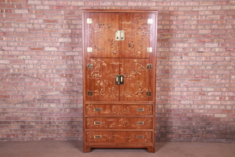 An exceptional midcentury Hollywood Regency chinoiserie Campaign style armoire dresser