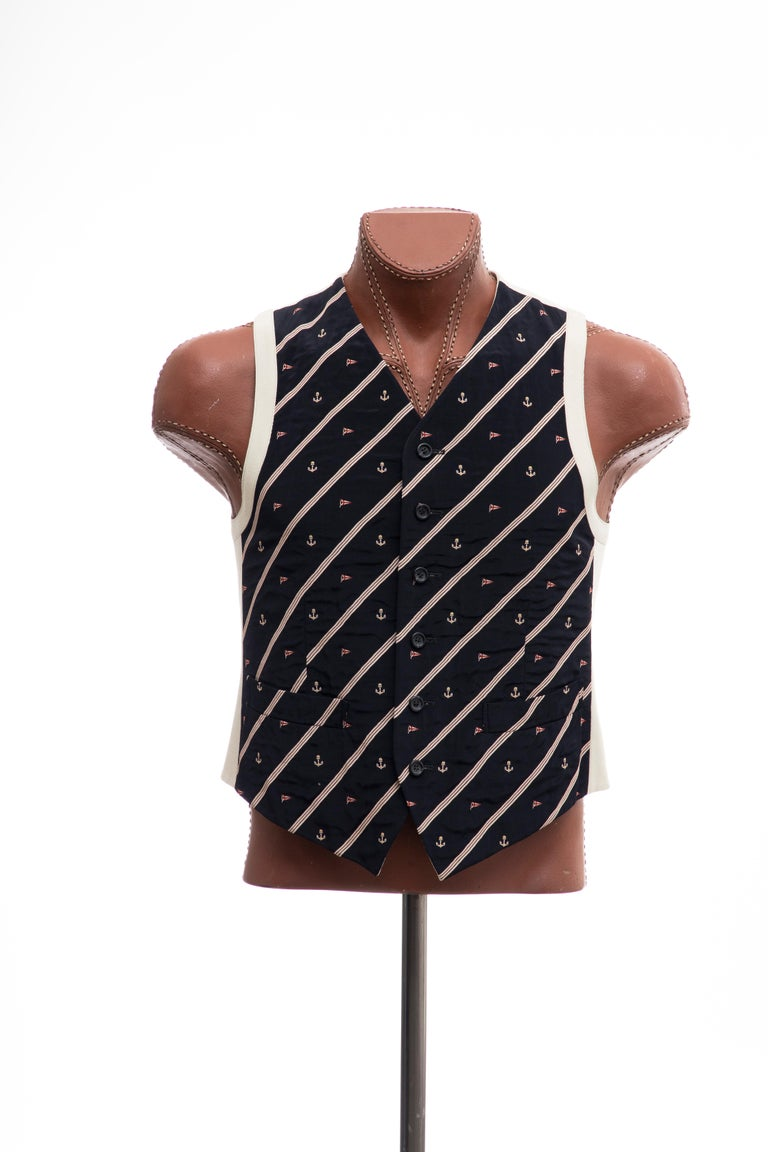 Dries Van Noten suit vest with nautical motifs and stripes at front,dual welt pockets at front, tonal satin lining and button closures at front.  IT. 48, US. 8  Chest: 40, Length: 24  Fabric: 48% Acetate, 48% Rayon, 4% Polyester