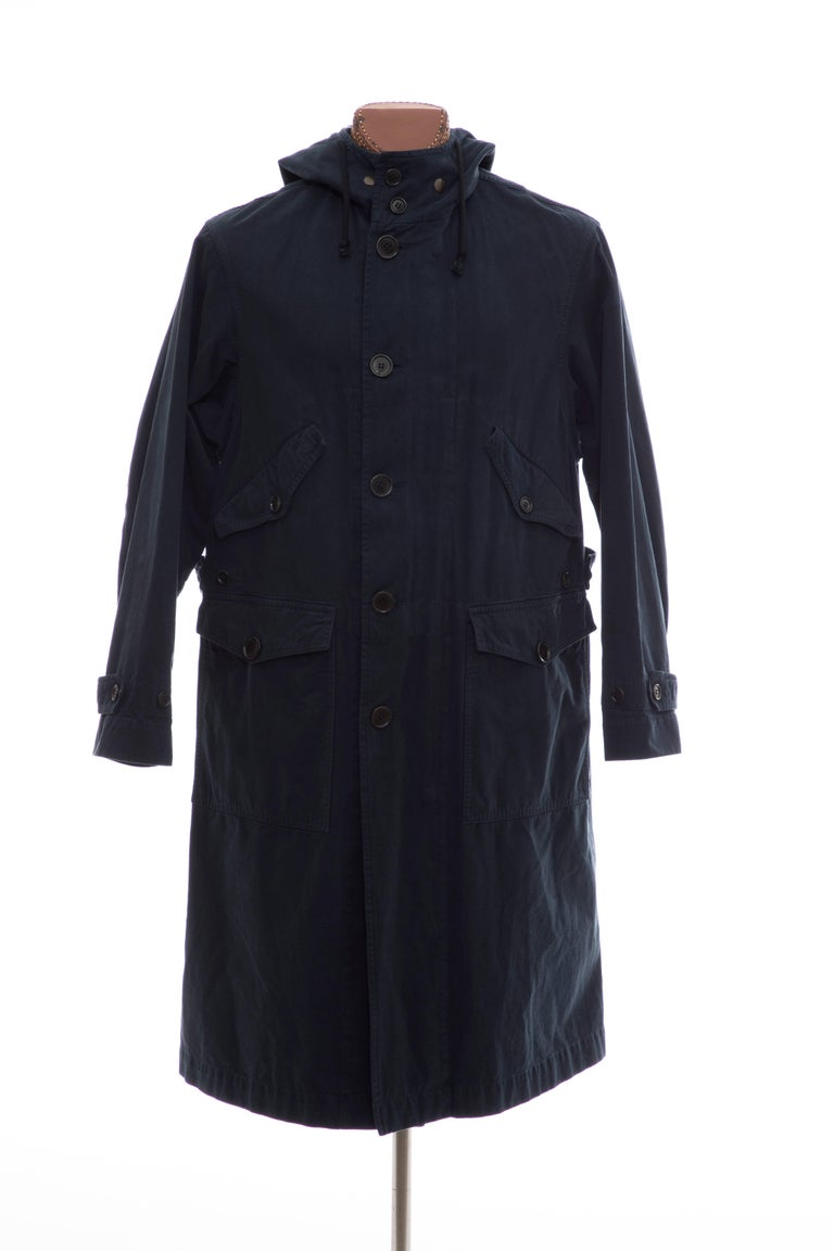Dries Van Noten, Fall 2016 men's dark slate and multicolor cotton Vaughn Parka with hood, dual flap pockets at chest, dual flap pockets at sides, patch at back and hidden zip and button closures at front.  Size: Large  Chest: 48, Shoulder 19.5,