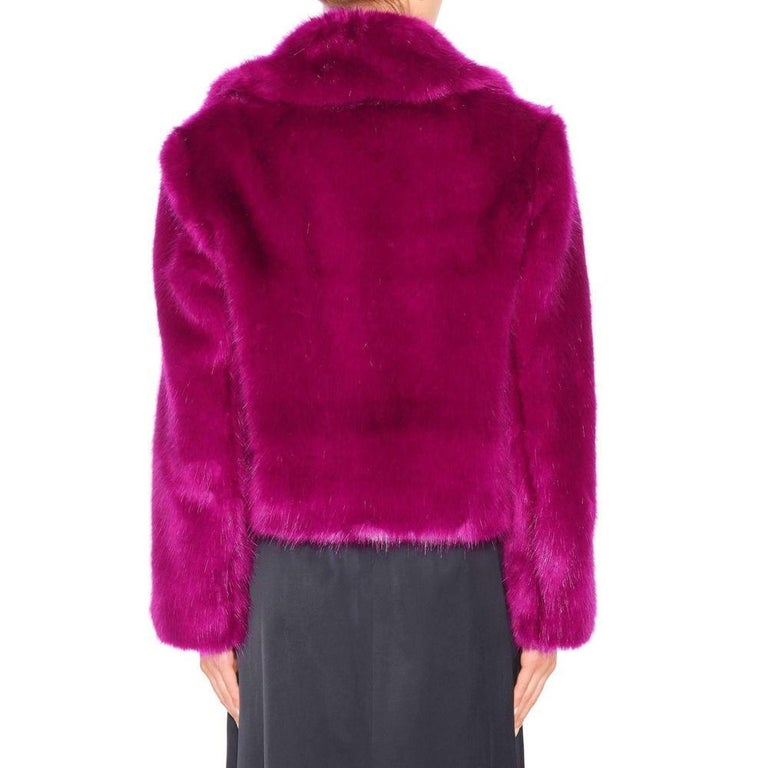 Few designers are able to play with texture quite like revered Antwerp master Dries Van Noten.   This short jacket makes a strong impact thanks to the combination of faux fur and bright pink.  Notch lapels. Open front. Lined with silky twill.