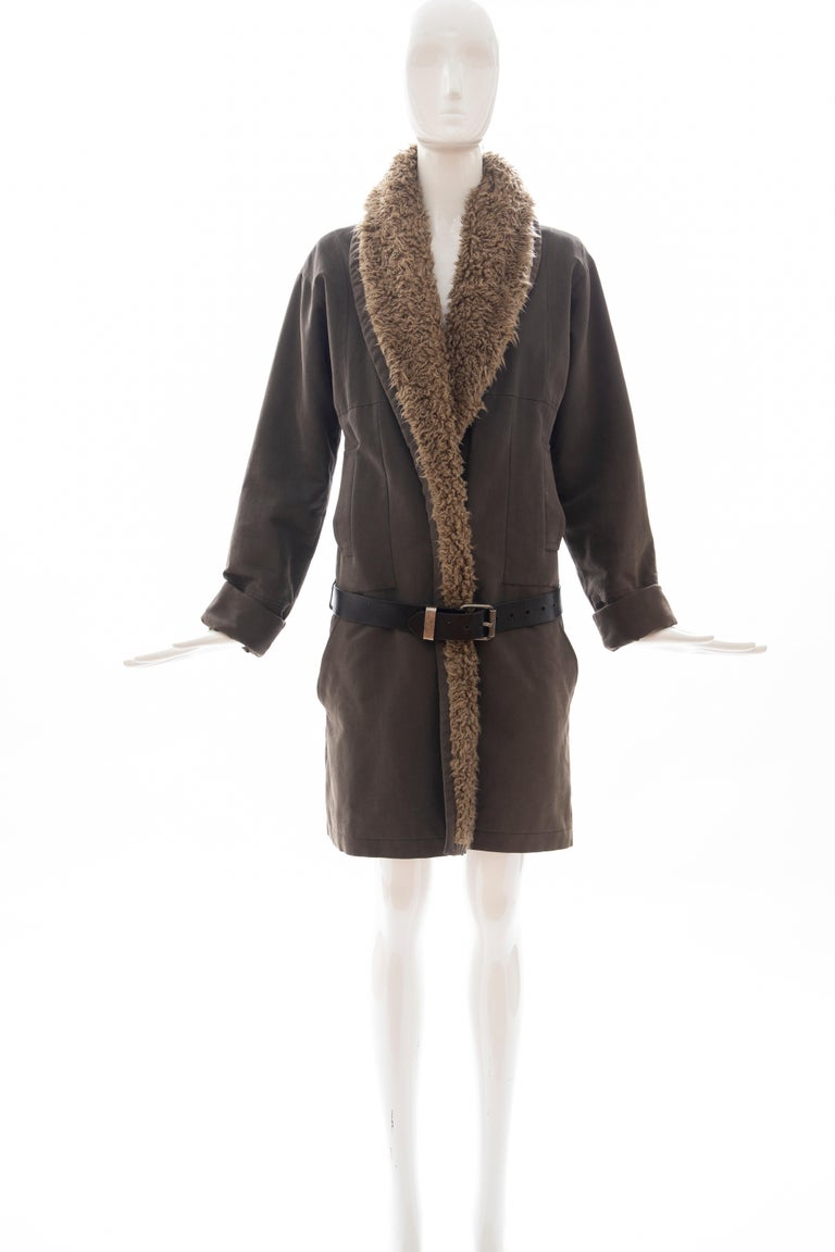Dries Van Noten, Runway Fall 2002 cotton button front coat featuring shawl lapels, dual pockets, leather belt closure at waist and fully lined.  EU. Small  Bust: 41