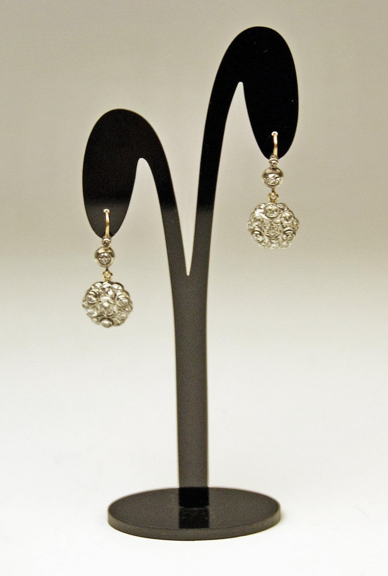 Stunning art nouveau viennese (austrian) pair of golden eardrops / dangle earrings: covered with many diamonds (vintage cut) having weight of 2.40 carats in total.  Elegant form type: These eardrops have the form type of a stylized flower's blossom