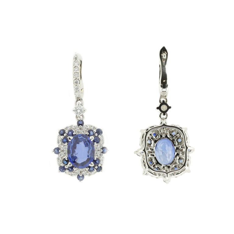 Modern Drop Earrings Set with Diamonds and Blue Sapphires Set in 18 Karat White Gold For Sale